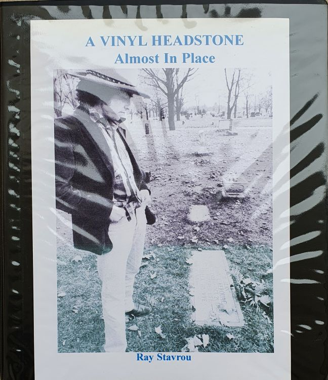a vinyl headstone almost in place Bob Dylan book