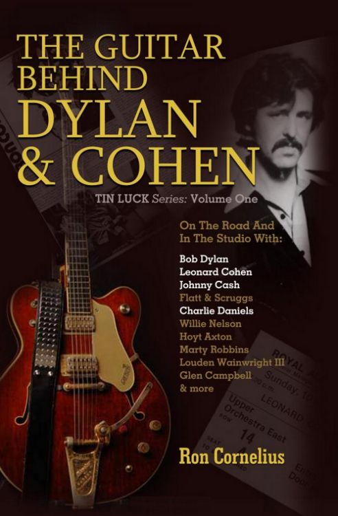 guitar behind Dylan and cohen book